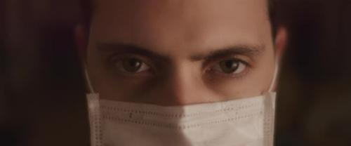 Videohive - Extreme Close up Of a Young Man Opening His Eyes While Wearing a Protective Mask - 26316003