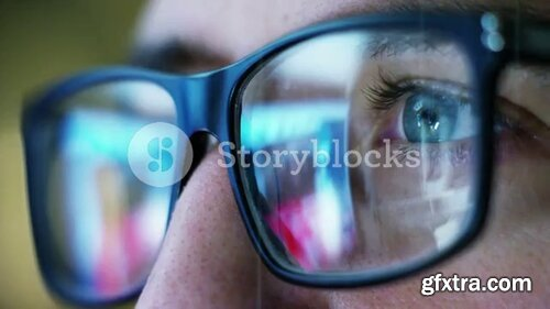 Videoblocks - Close up of young businessman with blue eyes wearing the glasses looking on the waveform lines expressed concept of stock market, growth stock market, economic profits, stock exchange | Footages