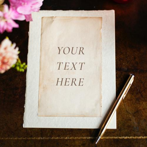 Vintage paper mockup on a wooden table with flowers - 1212421