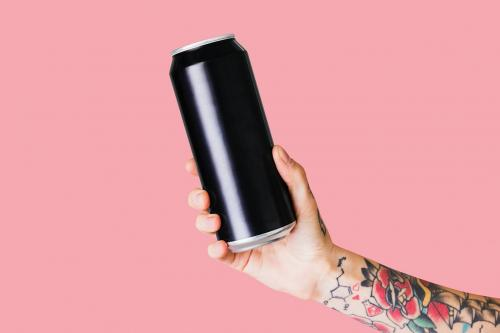 Hand holding a black aluminum can - 2050987