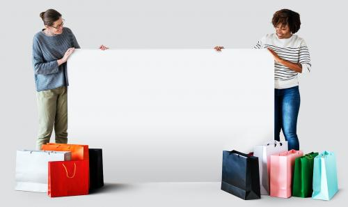 Women with shopping bags and a banner - 404907