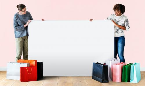 Women with shopping bags and a banner - 405044