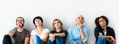 Diverse people sitting with thoughtful face expression - 414584