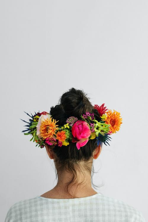 Beautiful woman with a midsummer floral wreath - 1207293