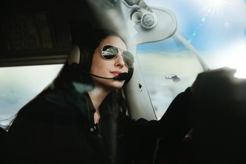 Aviator with headphones listening to the air traffic - 1202243