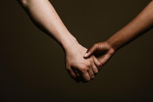 Black hand holding the white hand - 1203364
