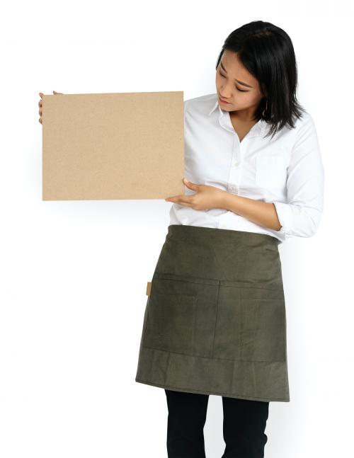 Woman wearing an apron holding an empty placard - 5669