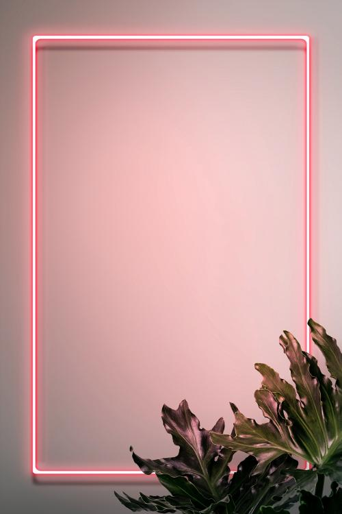 Pink neon frame on a wall with tropical plants mockup design - 1223339